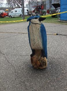 Painted blue jay chainsaw carving