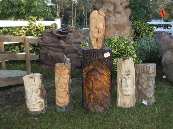 Faces chainsaw carvings of wood spirit native