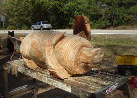 Pig chainsaw carving Florida