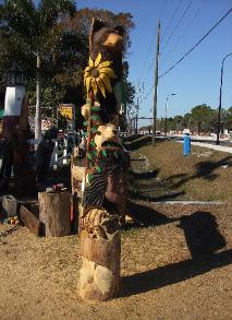 Chainsaw carving of wildlife totem pole